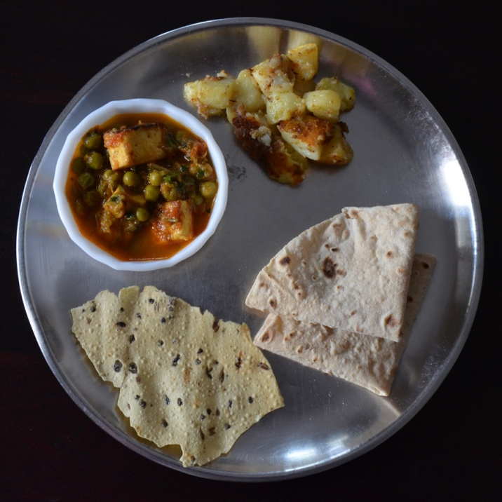 Leftover mutter paneer the next day with Jaini aloo, papad and rotis.